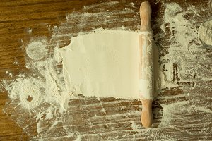 Flour and rolling pin on the table