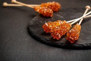 Sugar candy sticks on a grunge black table