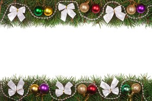 Christmas frame made of fir branches decorated with balls beads and silver bows isolated on white background