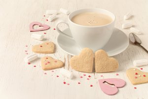 Valentines day heart shaped cookies and cup of coffee, tinted