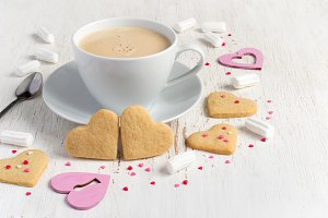 Valentines day heart shaped cookies and cup of coffee