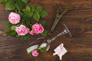 Wineglass with light pink roses and decorations