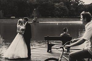 A wedding couple kisses