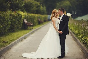 Groom kisses bride's nose tenderly