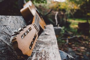 An old, broken acoustic guitar