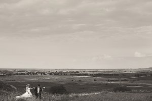 Wedding couple walking on the field