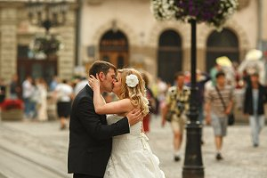 A passionate kiss of newlyweds