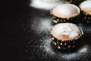 muffins in powdered sugar