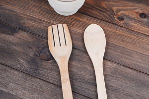 Wooden kitchen things. Fork, spoon, mortar