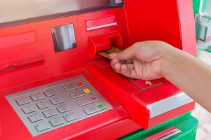 Hand insert credit card to ATM