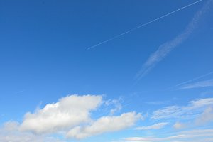 Clear Sky and Airplane with Trails