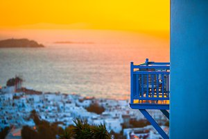 Beautiful colorful sunset of amazing greek town Mykonos