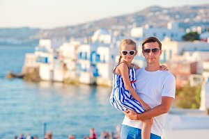 Family in Europe. Father and little girl background Little Venice in Mykonos