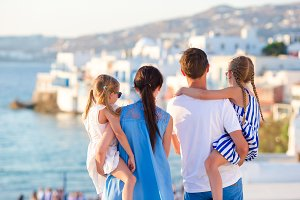 Family on vacation in Europe background the famous area in Mykonos