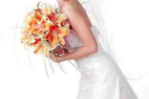 bride with bouquet of lilys