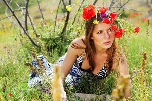 woman in dress on the   poppy field