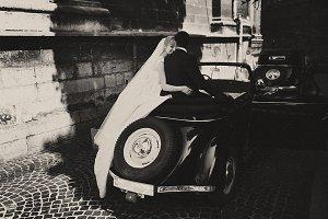 Wedding couple in a retro car