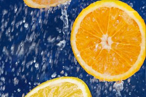 orange under drops of water