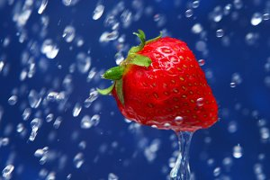 strawberry under drops of water