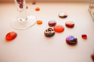 Wedding rings lie on  red stones