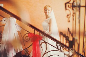 Pretty blonde bride goes upstairs