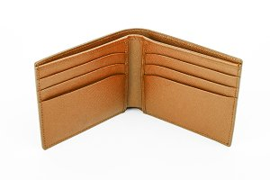 Open brown leather wallet isolated