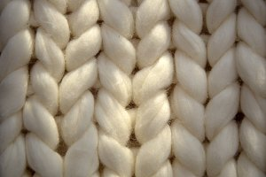 Hand Dyed Merino Wool. Close-up of knitted blanket, merino wool background