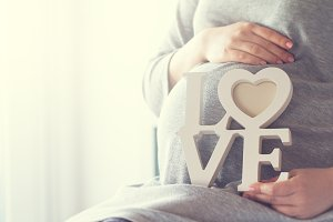 Maternity or love concept with woman