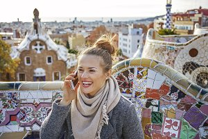 traveller woman at Guell Park in Barcelona speaking on cellphone