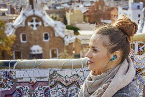 traveller woman in Barcelona listening audioguide