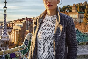 traveller woman at Guell Park in Barcelona looking into distance