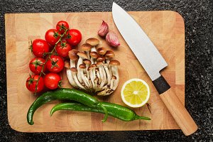 fresh vegetables on board and knife