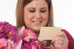 Woman reading flowers card