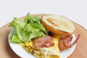 Omelet with bacon and toast.