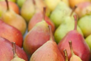 pears on the counter market as background