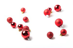 Red Christmas baubles on white