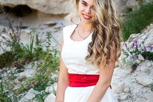 Beautiful model posing in the bosom of green nature