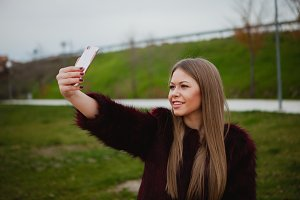 Fashion young woman with a mobile