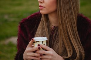 Pretty woman drinking a coffee