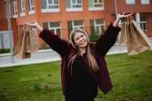Happy blonde woman shopping