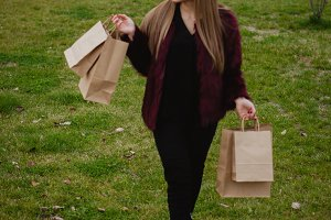 Happy blonde woman shopping