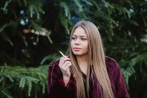 Blonde young girl smoking