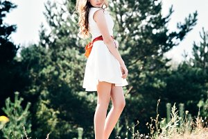 Summer photo smiling girl in a white dress