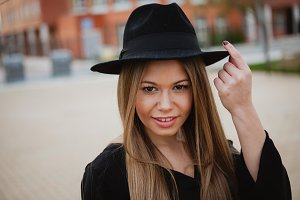 Stylish blonde girl with hat