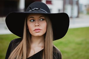 Stylish girl with black hat
