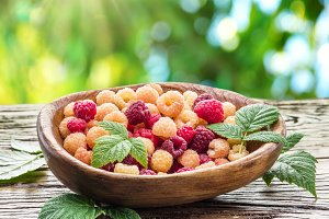Raspberries in the wooden bowl