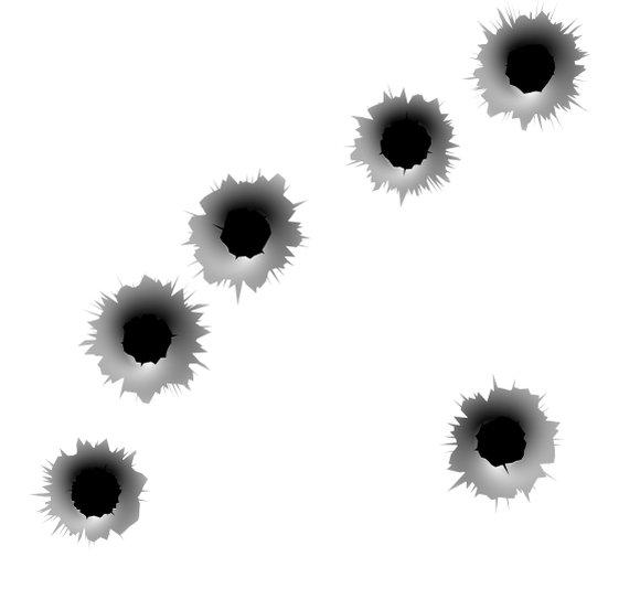 Bullet Holes In Metal Target