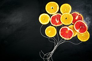 Food art concept with fruit slices