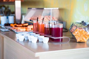 Fresh and delisious breakfast in outdoor cafe. Different choice of juices on table