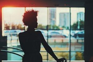 Brazilian girl in front of window